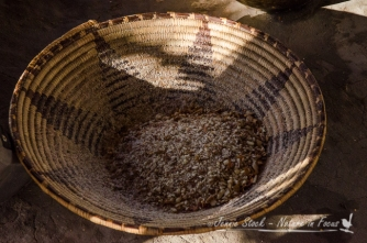 Ground mahangu in grass basket